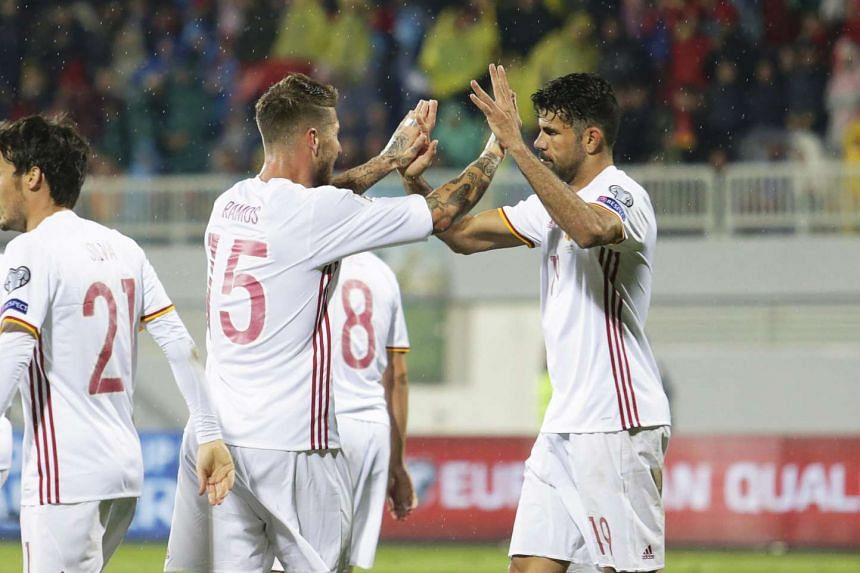 Spain's Diego Costa (right) celebrates with his teammate Sergio Ramos (left) after scoring the 1-0 lead during the Fifa World Cup 2018 qualifying group G soccer match between Albania and Spain in Shkoder, Albania, on Oct 9, 2016.