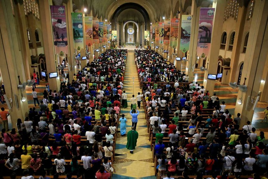 Filipino Catholic devotees attend a regular mass at a National Shrine of Our Mother of Perpetual Help in Baclaran, metro Manila, Philippines.