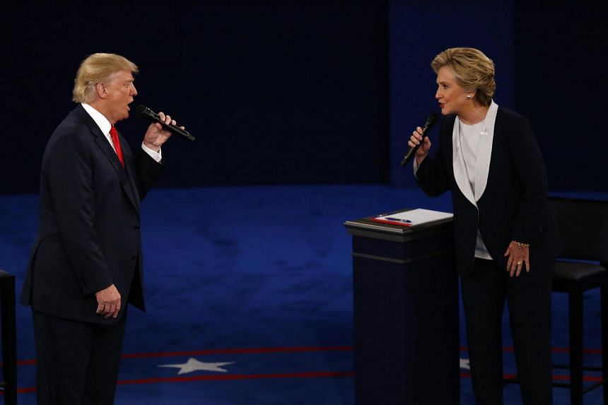 Donald Trump and Hillary Clinton spar at the presidential debate at Washington University in St. Louis.