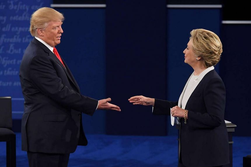 Democratic presidential candidate Hillary Clinton and Republican presidential candidate Donald Trump shake hands after the second presidential debate at Washington University in St. Louis.