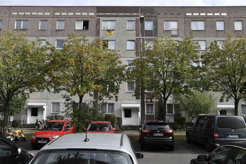 This picture shows the flat (upper centre-right) on a block in Leipzig Paunsdorf, eastern Germany, where a Syrian man has been arrested for plotting a bomb attack.