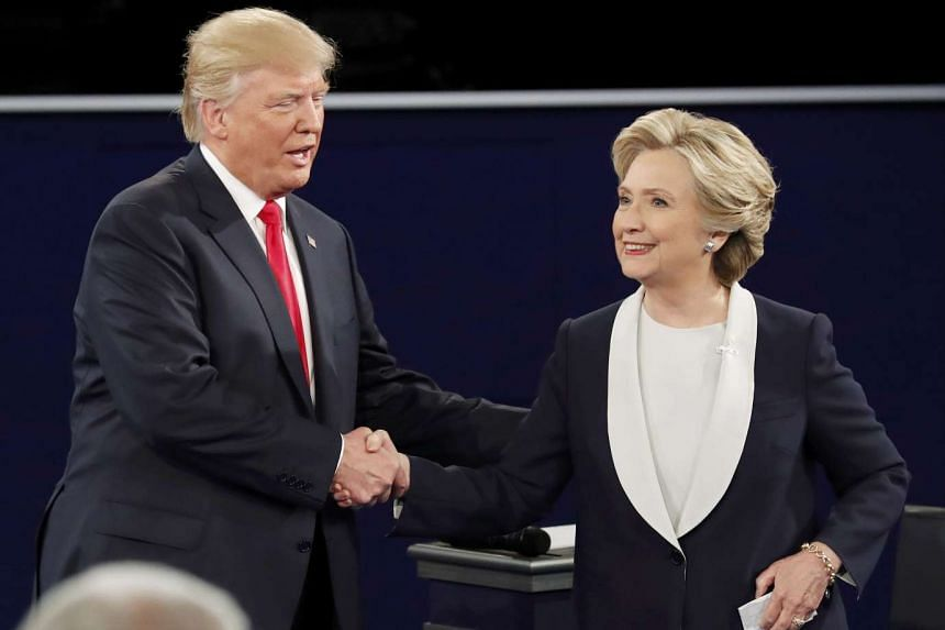Republican presidential nominee Donald Trump and Democratic presidential nominee Hillary Clinton at the end of their presidential town hall debate at Washington University on Oct 9, 2016.