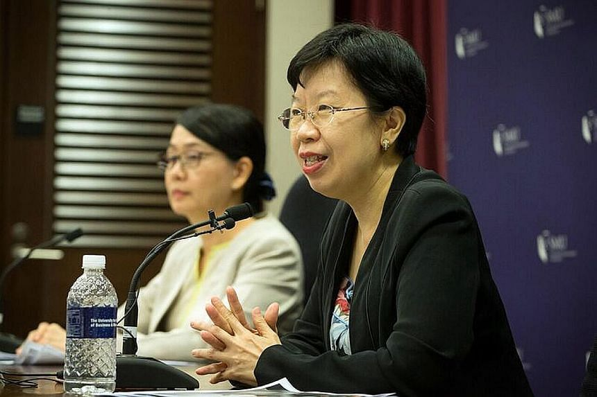 """SMU provost Lily Kong (right) at a media briefing last week. She said the scholarship aims to attract students who desire a """"balance between local rootedness and global exposure""""."""