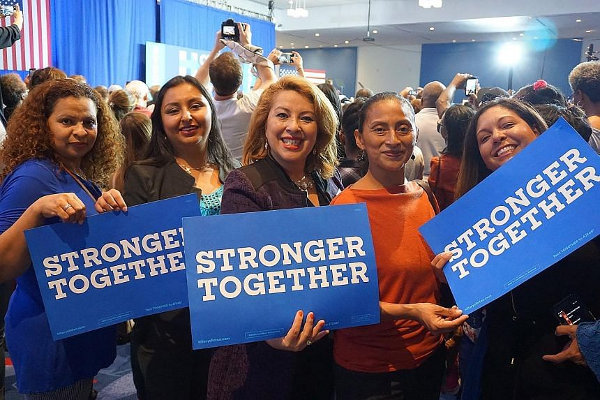 """Latino voters at a Democratic rally in Charlotte last week. North Carolina used to be a """"comfortable"""" Republican state, but urban centres such as Raleigh, Charlotte and Durham are growing rapidly, attracting people with different political views and"""