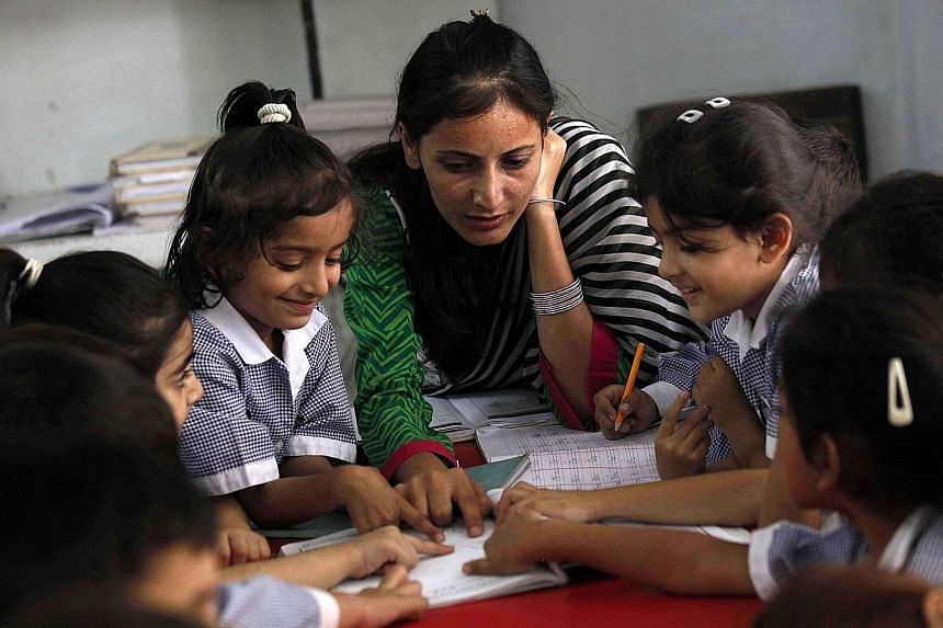 """A school in Peshawar, Pakistan, on World Teachers' Day last Wednesday. In order to develop teacher quality, nations need to do far more than """"borrow"""" policies from high-scoring nations. Nations can learn from one another, but this requires a systemat"""