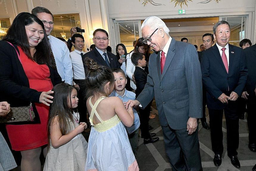 President Tony Tan Keng Yam mingling with Singaporeans and their families at a reception at Grand Hotel Oslo in Norway yesterday. Also present was Singapore's non-resident Ambassador to Norway Ng Ser Miang (at right).