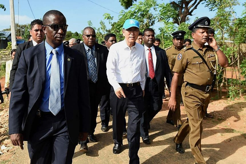 Mr Ban (centre) in Sri Lanka last month, his first trip to the island since its civil war ended. During his term as UN chief, he has promoted sustainable development, pushed for women's rights and strengthened peace efforts.
