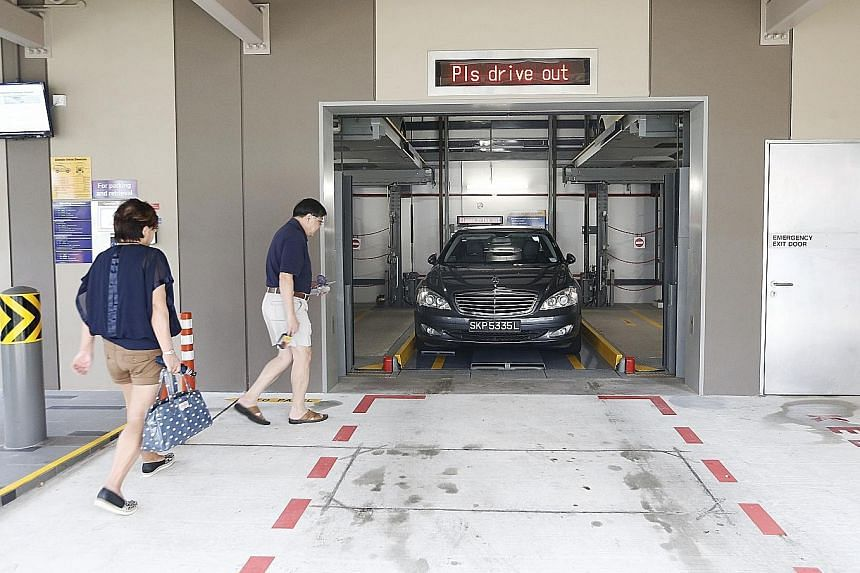 A couple collecting their car from a mechanised carpark in Yishun. While some users say the system is convenient and safe, others feel the waiting time is too long.