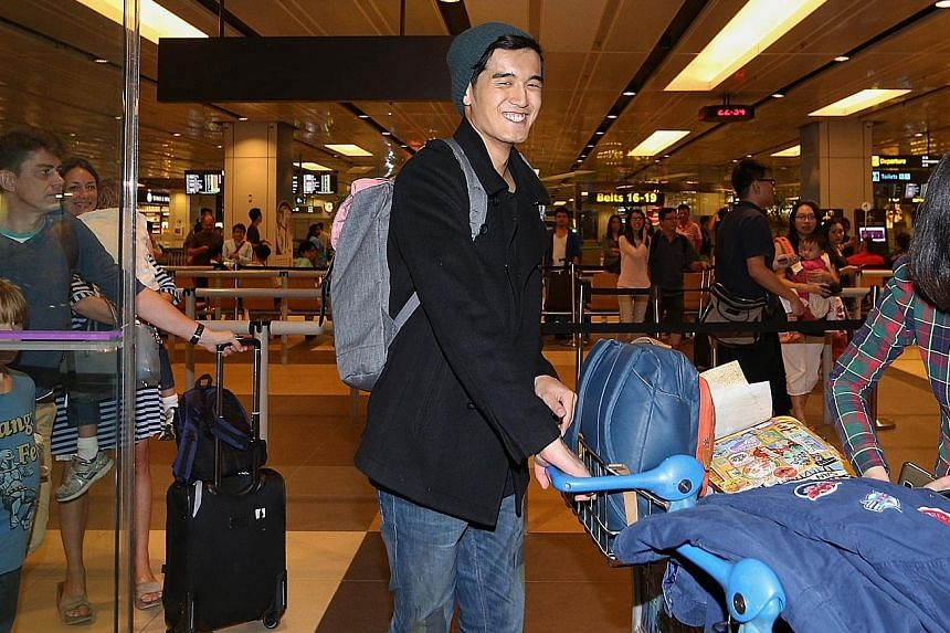 Nathan Hartono, the first Singaporean to reach the finals of the immensely popular Sing! China show, returned home yesterday at around 10.40pm to about 20 fans who had gathered at Changi Airport Terminal 1 to receive him. Last Friday, the 25-year-old