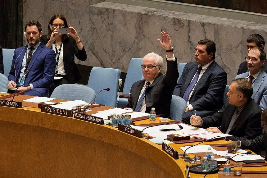 Russia's ambassador to the United Nations, Mr Vitaly Churkin, raising his hand to veto a resolution in the Security Council demanding an end to the bombing of Aleppo.