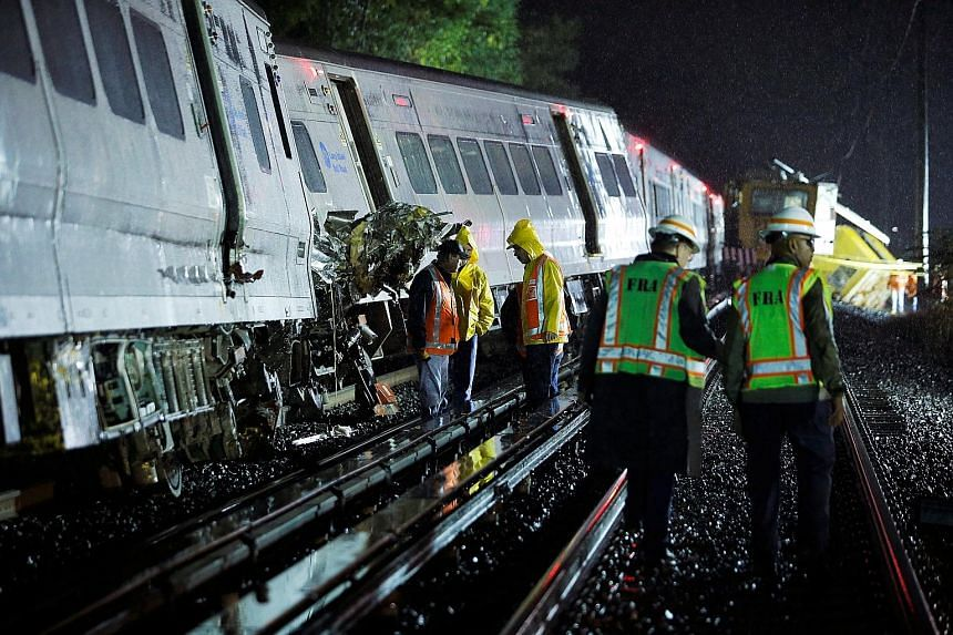 Emergency responders working at the scene of the derailed train near the community of New Hyde Park on Long Island in New York.