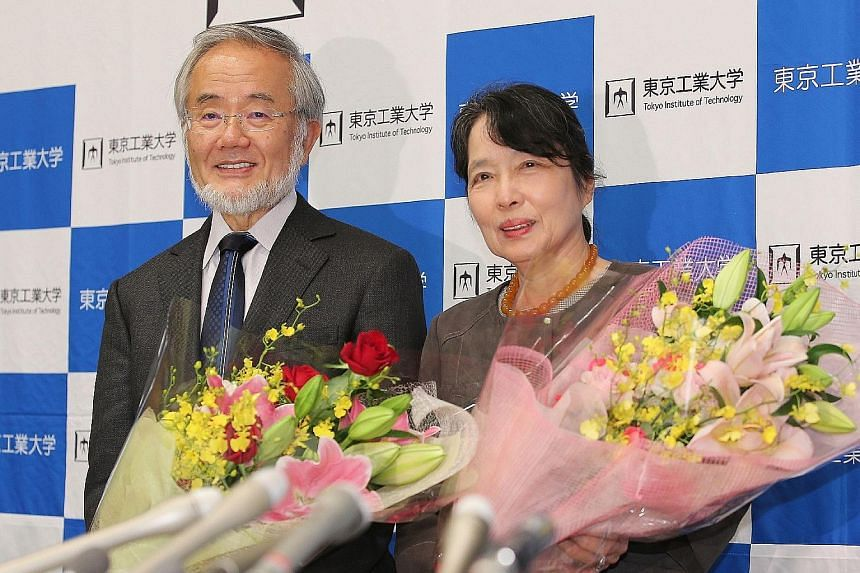 """Dr Ohsumi and his wife Mariko at the Tokyo Institute of Technology last Tuesday. Japanese Prime Minister Shinzo Abe said that Dr Ohsumi's work """"has brought light to people struggling with intractable diseases""""."""