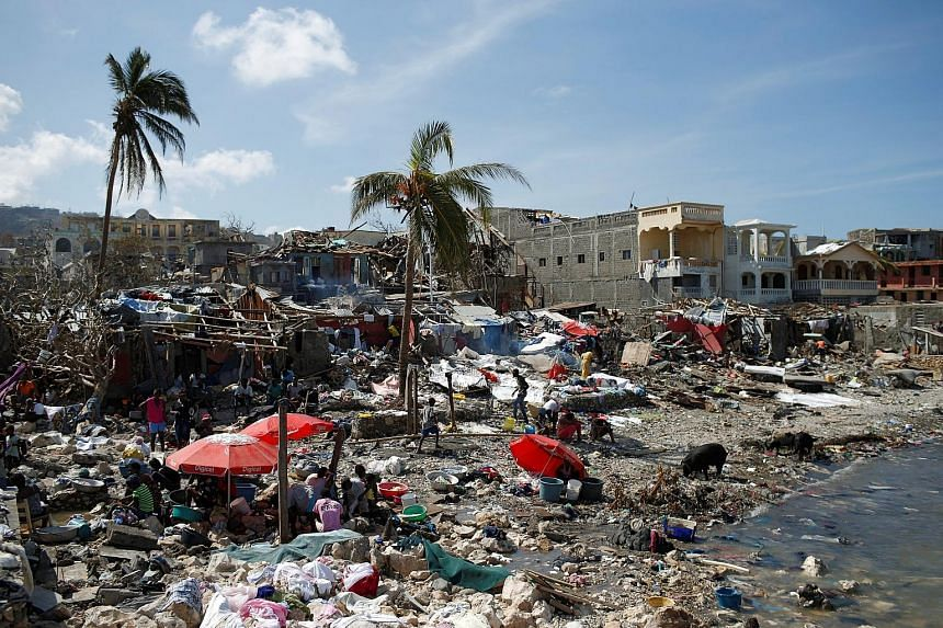 Homeless people gather in makeshift shelters on the shore in Jeremie, Haiti, in the aftermath of Hurricane Matthew. At least 13 people on the Caribbean island have died from cholera since the storm hit. The disease causes severe diarrhoea and can kil