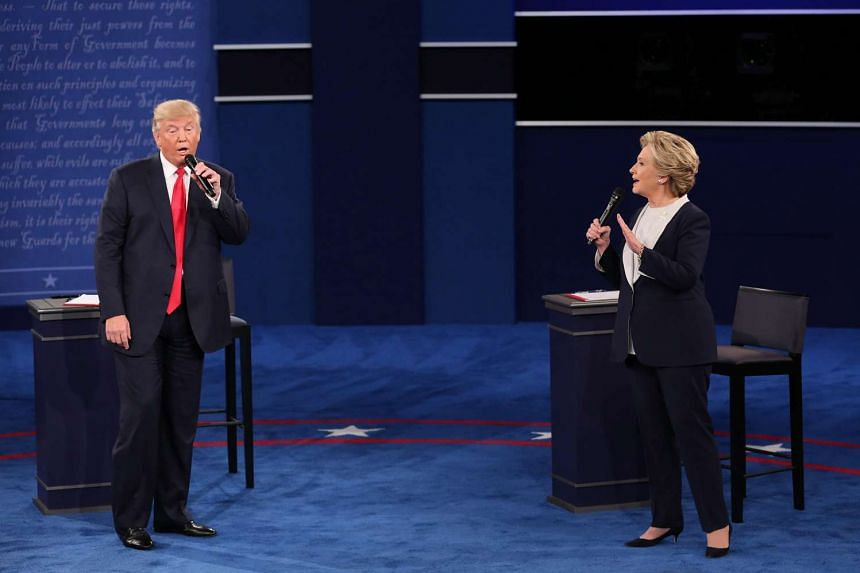 Donald Trump and Hillary Clinton speak during the second US presidential debate.