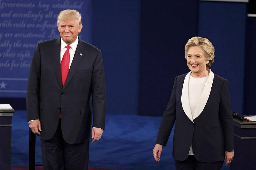 Donald Trump and Hillary Clinton stand together before the start of their town hall debate.