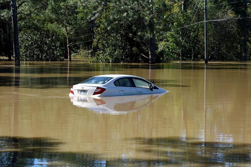 A car is submerged after flooding caused by Hurricane Matthew, in Hope Mills, North Carolina, US, on Oct 9, 2016.
