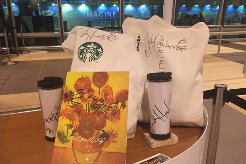 Autographed bags and tumblers that Nathan Hartono signed for his fans.