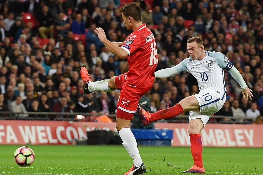 England's Wayne Rooney attempts a shot on the Maltese goal during the Fifa World Cup 2018 qualifying soccer match between England and Malta on Oct 8, 2016.
