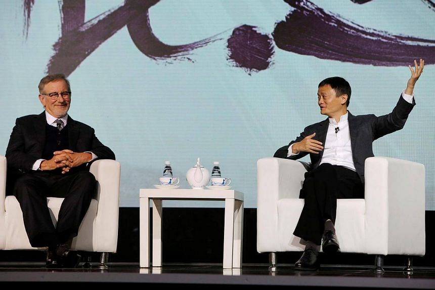 Steven Spielberg (left) with Mr Jack Ma announce a partnership between Alibaba Pictures Group Limited and Amblin Partners in Beijing on Oct 9, 2016.