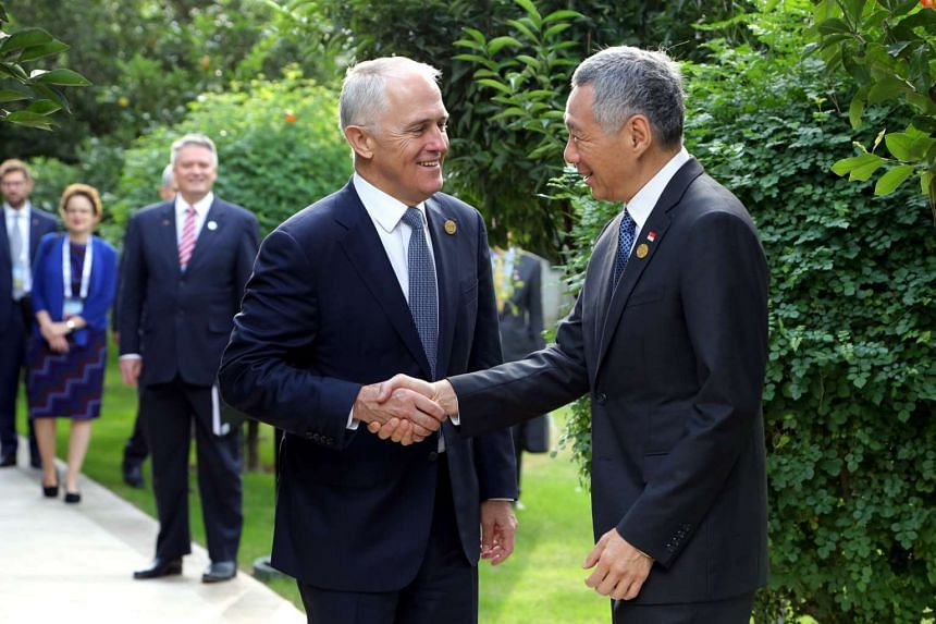 Prime Minister Lee Hsien Loong (right), shaking hands with Australian Prime Minister Malcolm Turnbull during the G20 Summit held in Antalya, Turkey.