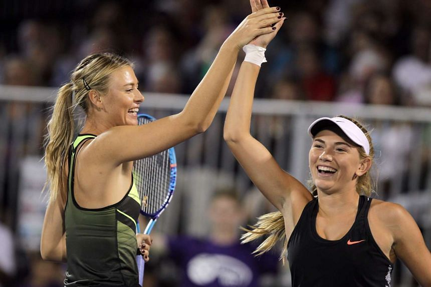 Maria Sharapova (left) and Taylor Johnson at the World Team Tennis Smash Hits charity tennis event on Oct 10, 2016.