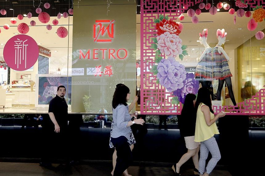 Shoppers walk past department store Metro in The Centrepoint at Orchard Road on March 4, 2015.