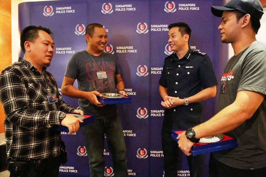 (From left to right) Mr Teoh Kwan Yi Gabriel, Mr Norazam Sumadi and Mr Muhammad Firdauz Mansor receiving their awards from Commander of Jurong Division, Assistant Commissioner of Police Koh Wei Keong.
