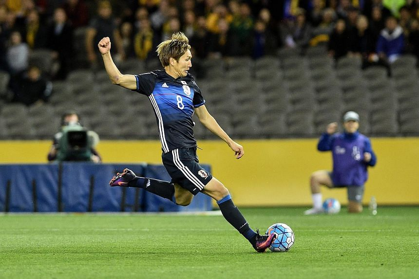 Japan's Genki Haraguchi kicks a goal during the 2018 FIFA World Cup qualifying soccer match between Australia and Japan on Oct 11, 2016.