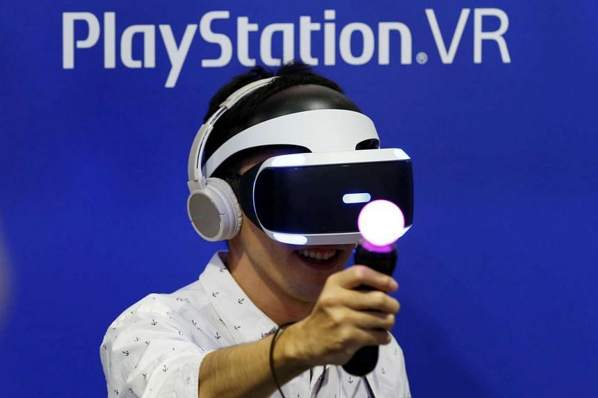 A man plays a video game with Sony's PlayStation VR headset at Tokyo Game Show 2016 on Sept 15, 2016.