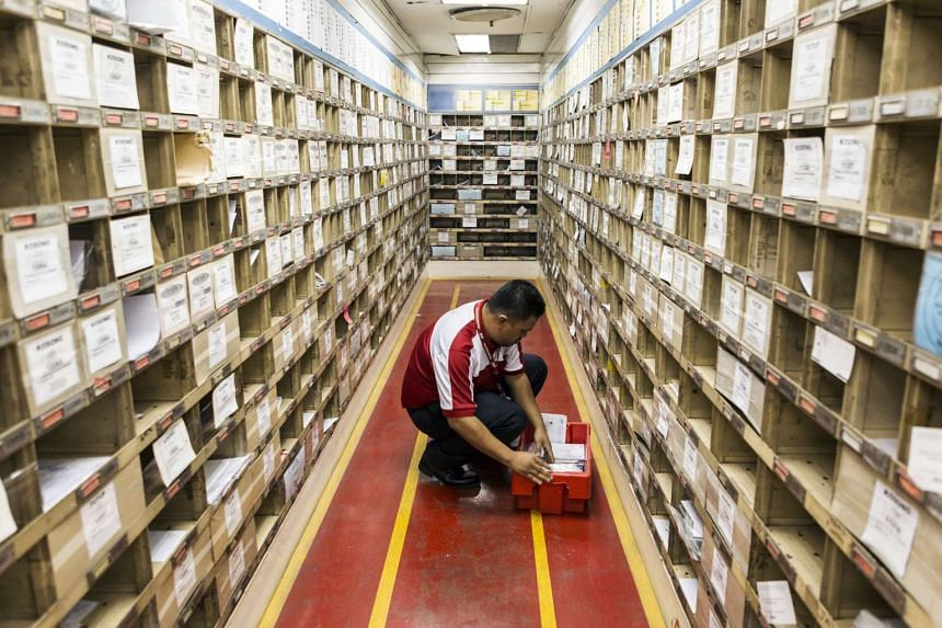 An employee arranges mail in a sorting area at the Pos Malaysia Bhd Dayabumi Complex post office in Kuala Lumpur on Sept 27, 2016.