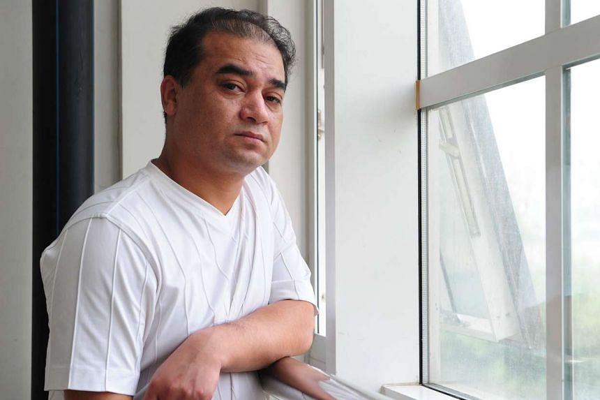 University professor, blogger, and member of the Muslim Uighur minority, Ilham Tohti, on June 12, 2010.