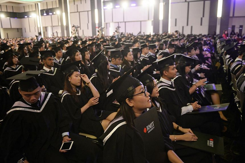 Graduates at the SIM-RMIT University degree conferment and awards ceremony for Bachelor of Business (Management) at the Singapore Institute of Management on Aug 27, 2015.
