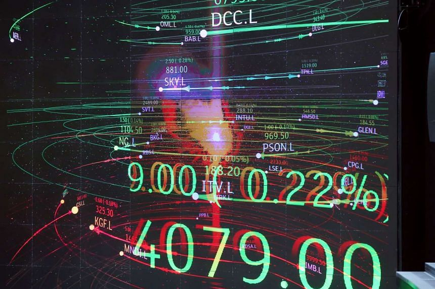 Share prices of FTSE 100 companies are displayed on a screen in the atrium of the London Stock Exchange Group Plc's offices on July 25, 2016.