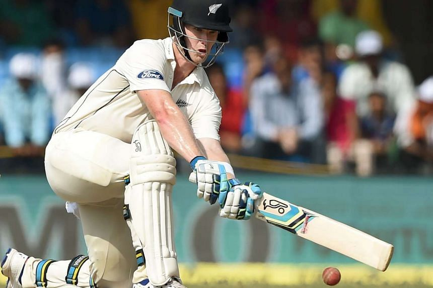New Zealand batsman James Neesham plays a shot on the third day of the third Test cricket match between India and New Zealand  at the Holkar Cricket Stadium in Indore, on Oct 10, 2016.