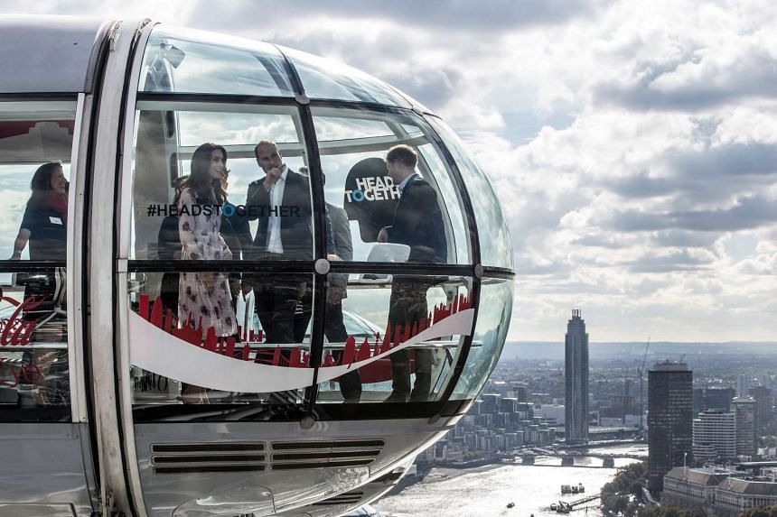"""Britain's Princes' William and Harry, and Kate, The Duchess of Cambridge take a ride in a pod of the London Eye with members of the mental health charity """"Heads together"""" on world mental health day in London, Britain on Oct 10, 2016."""