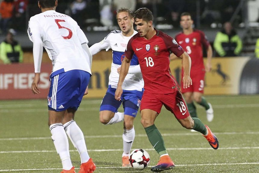Portugal's Andre Silva (right) in action against Hallur Hansson (centre) of Faroe Islands during the Fifa World Cup 2018 qualification match between Faroe Islands and Portugal at the Torsvollur stadium in Thorshavn, Faroe Islands, on Oct 10, 2016.