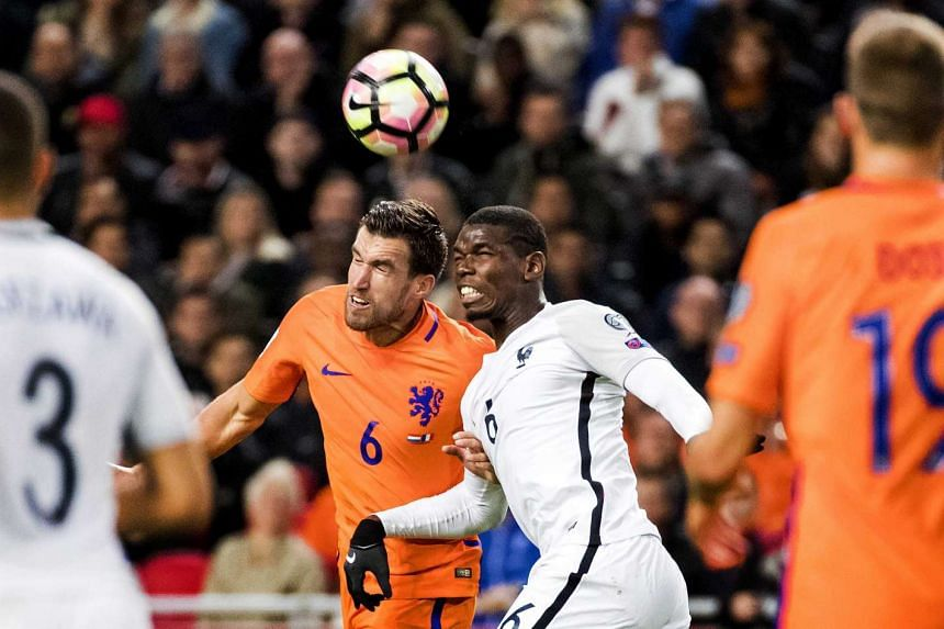 Kevin Strootman (left) of the Netherlands and Paul Pogba of France in action during the Fifa World Cup 2018 qualifying soccer match between the Netherlands and France in Amsterdam, The Netherlands, on Oct 10, 2016.