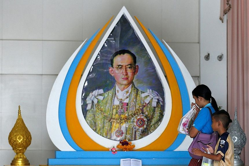 Well-wishers in front of a picture of Thailand's King Bhumibol Adulyadej at Siriraj Hospital.