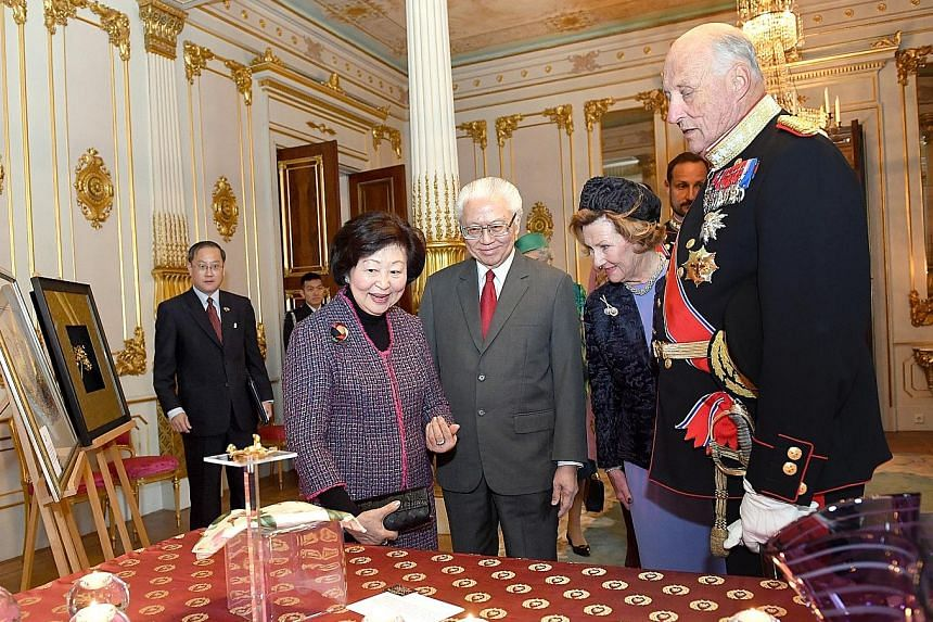From left: Mrs Mary Tan, President Tony Tan Keng Yam and Norway's royal couple, Queen Sonja and King Harald V, admiring the gifts which they exchanged at the Royal Palace in Oslo yesterday.