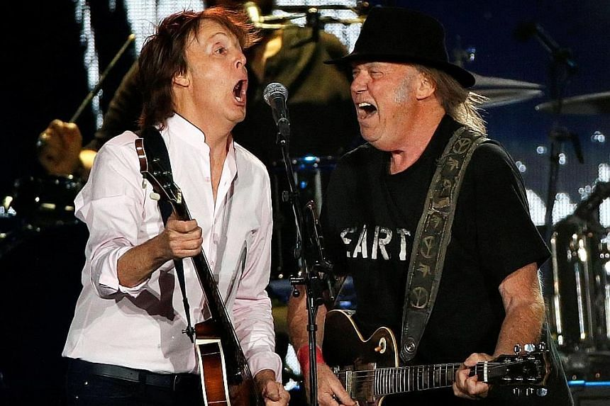 Paul McCartney (left) and Neil Young performed a mash-up that built into the anthem Give Peace A Chance.