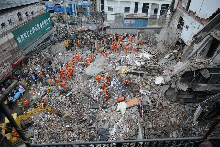 The collapse of a series of buildings built by local villagers and packed with migrant workers in China has killed at least 17 people, according to the government and reports. The four multi-storey residential buildings caved in during the early hour