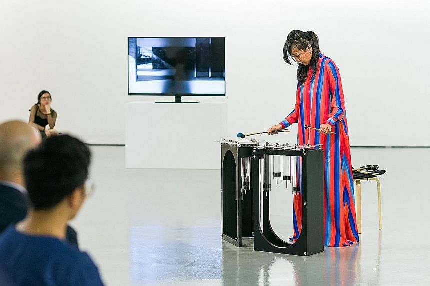 Vivian Wang playing Instrument B (Vivian), which was named after the Singapore musician. It is one of New Zealand artist Sriwhana Spong's works in the show.