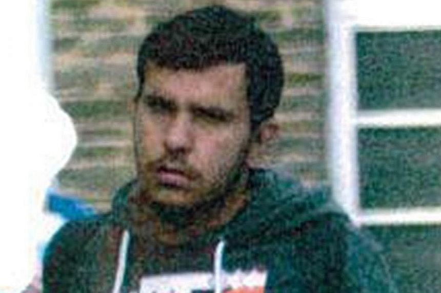Above: German investigators outside the apartment complex in Leipzig yesterday where Jaber Albakr was arrested. Below: Albakr, seen here in a police handout photo, was arrested after three of his fellow Syrians detained him in their apartment before