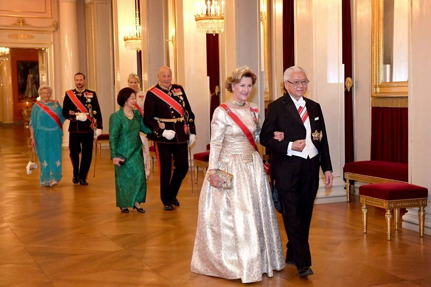President Tony Tan Keng Yam and Queen Sonja, followed by King Harald V with Mrs Mary Tan, arrive for a gala dinner at the Royal Palace in Oslo, Norway. The dinner was hosted by the King and Queen in honour of President Tan.