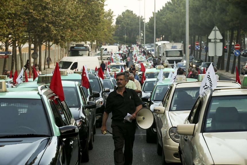 Taxi drivers rally during a strike action promoted by the National Association of Road Carriers for Passenger Cars (ANTRAL) and the Portuguese Federation of Taxi, to protest against the regulation of the activity of passenger transport platforms lik