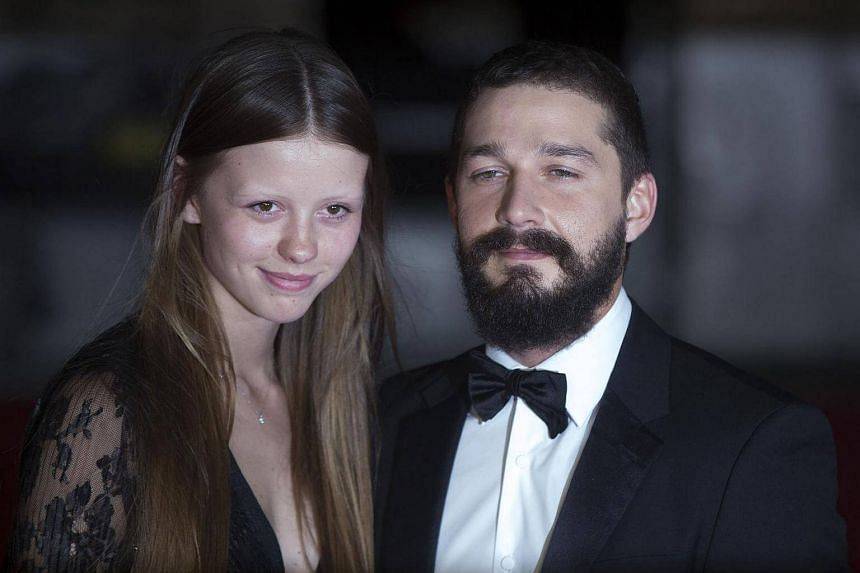 Shia LaBeouf (right) poses with girlfriend Mia Goth before a gala screening of his film Fury in London, on Oct 19, 2016.
