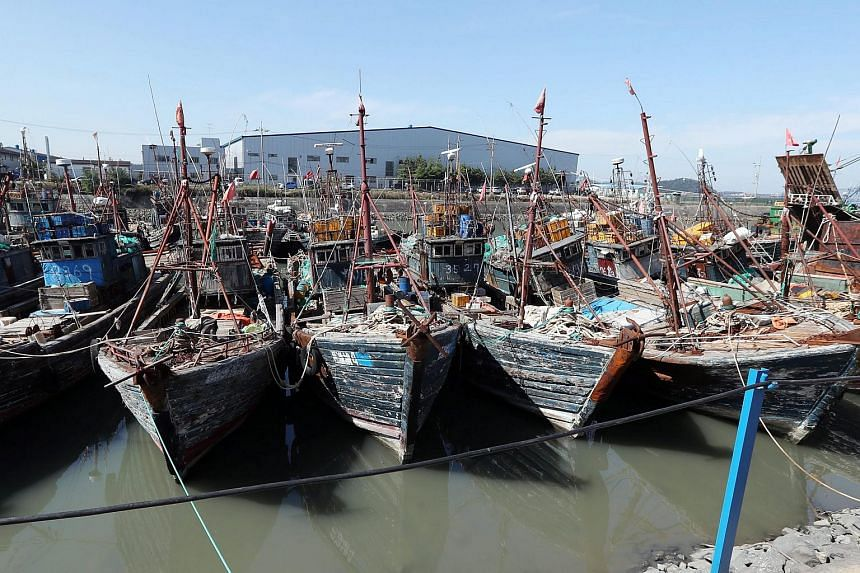 Several Chinese fishing boats that were caught while reportedly operating illegally in South Korea's exclusive zone are moored at a port in Incheon on Oct 10, 2016.