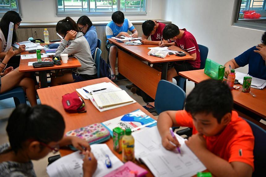Children study in the study corner in Punggol West on Oct 12, 2016.