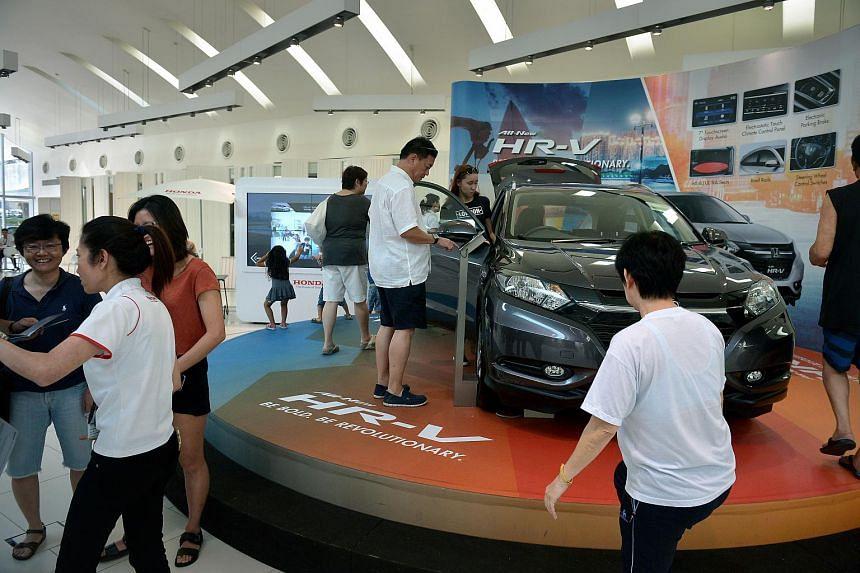 Car buyers at the Honda showroom at Leng Kee Road.