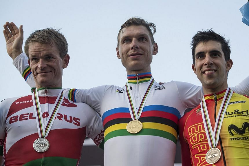 Vasil Kiryienka, Tony Martin and Jonathan Castroviejo Nicolas on the podium of the Men's Elite Individual Time Trial event at the 2016 Cycling Road World Championships on Oct 12, 2016.